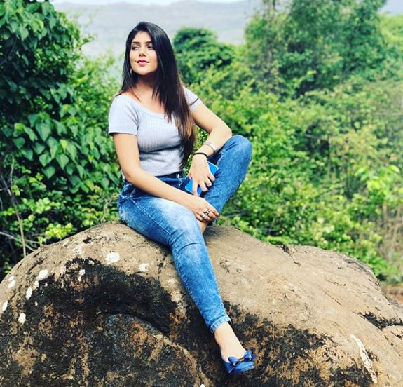 ishitha chauhan sitting on rock