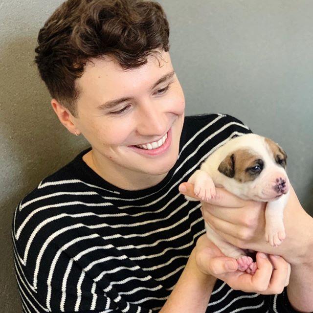 Dan Howell with cub